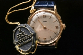 Ebel - watch with 18 kt gold case & hang tag