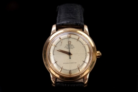 Omega - watch with 18 kt gold case from the 50s (French manufacture)