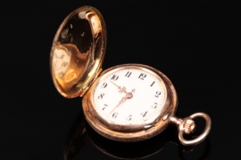 Golden pocket watch with enamel ornament
