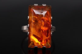 Silver ring with polished amber