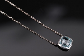 Silver necklace with light blue topaz