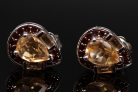 Silver ear studs with different shaped citrines