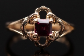 Gold plated silver ring with magenta colored garnet