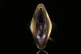 Golden ring with amethyst in an elongated-oval-cut