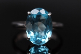 Silver ring with oval-cut topaz