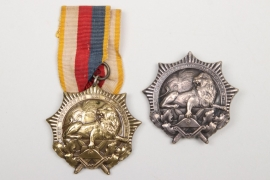 "Imperial Germany - two Colonial Badges ""Lion Order"""