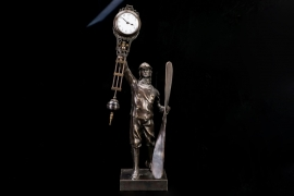Junghans - Bronze figure of a pilot & pendulum shaped clock 20s/30s