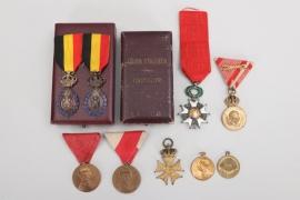 Lot of nine international badges