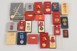 East Germany (GDR)  - lot of badges with their cases of issue