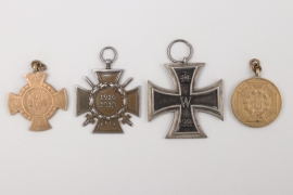 Lot of four badges