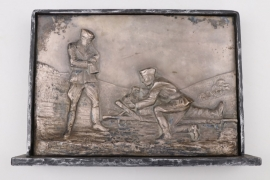 Framed relief with stand showing three soldiers