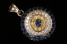Round pendant with sapphires and other colorful gemstones