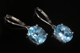 Silver earrings with light blue topazes