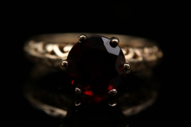 Gold plated silver ring with a Mozambique garnet