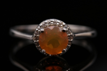 Silver ring with orange 'Buriti' opal and small white gemstones
