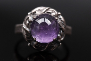 Silver ring with amethyst cabochon