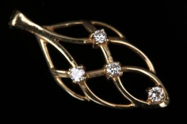 Delicate leaf shaped diamond pendant