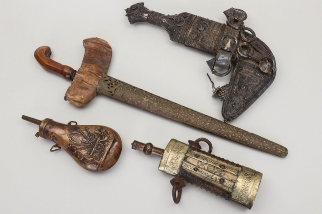 Lot of oriental daggers &  powder flasks