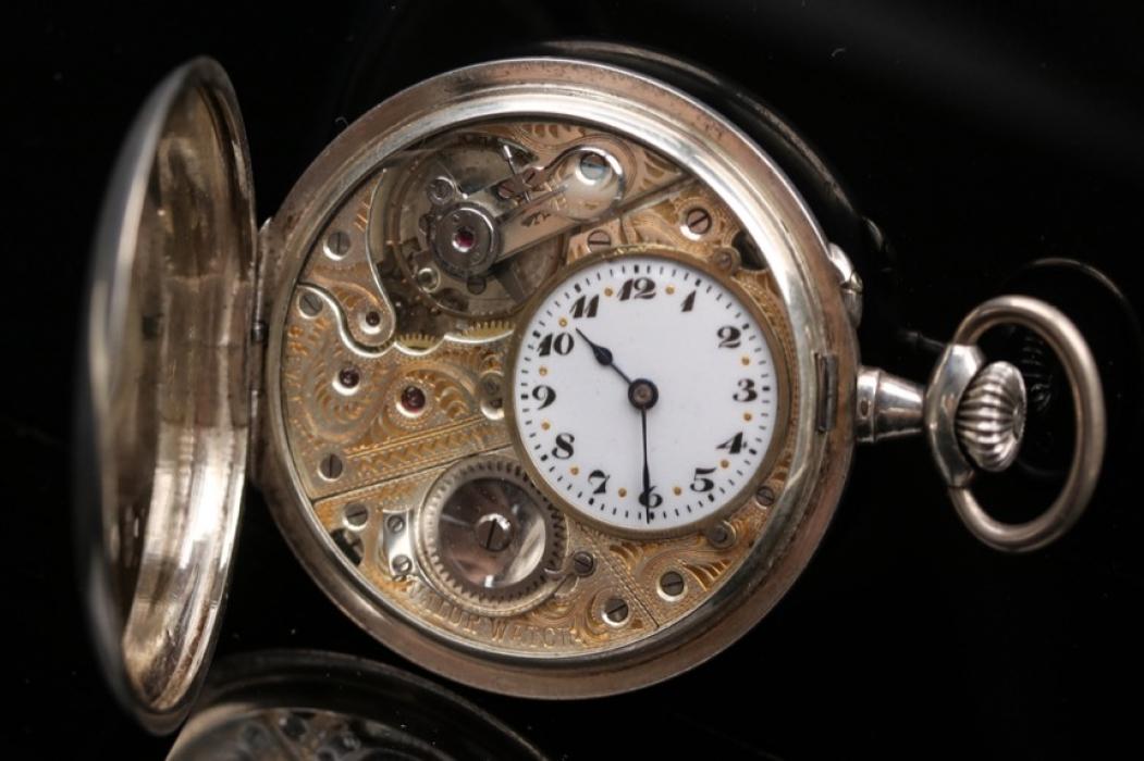 Silver pocket watch with open clockwork