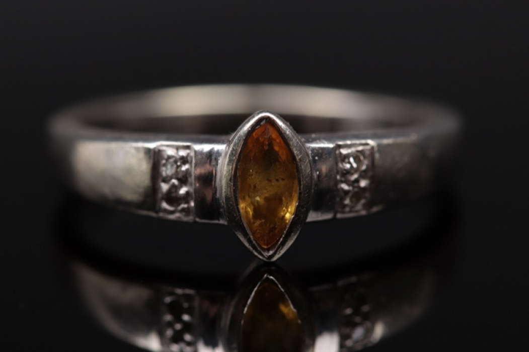 White golden ring with yellow sapphire and diamonds