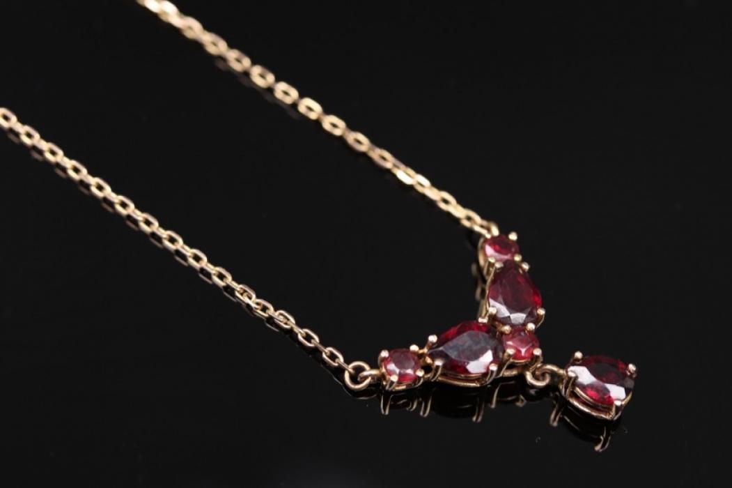 Golden, red garnet necklace