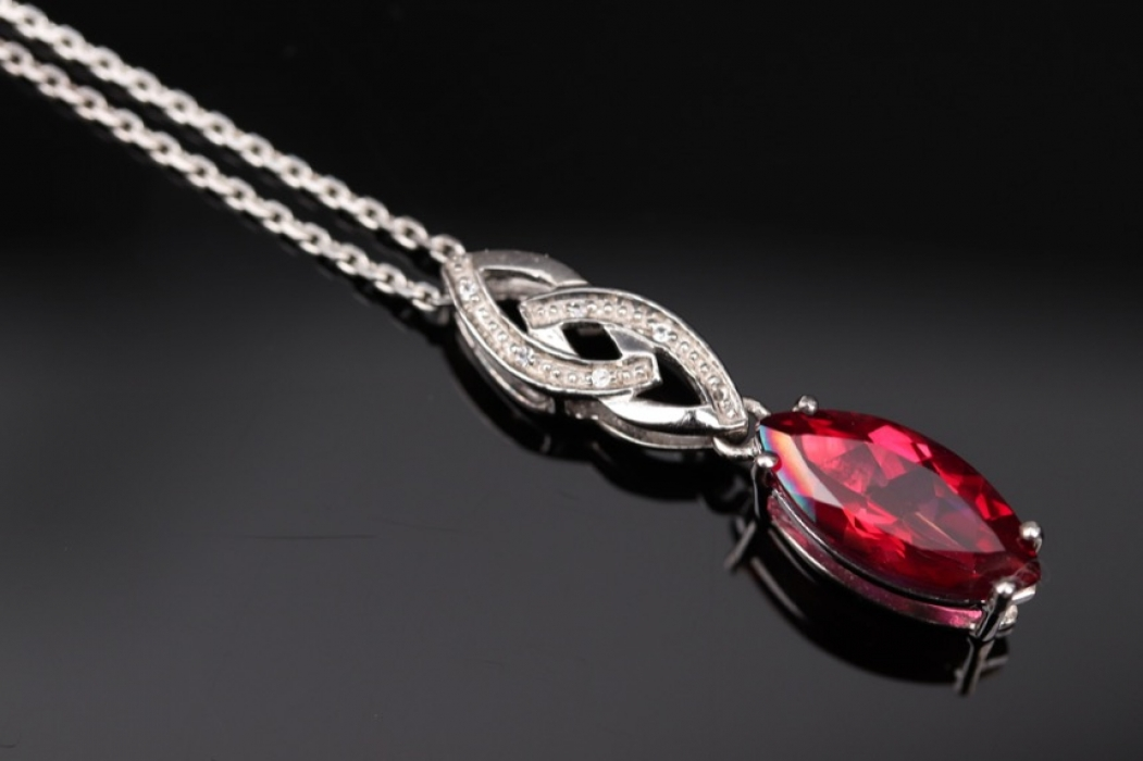 Silver necklace with deep pink topaz pendant