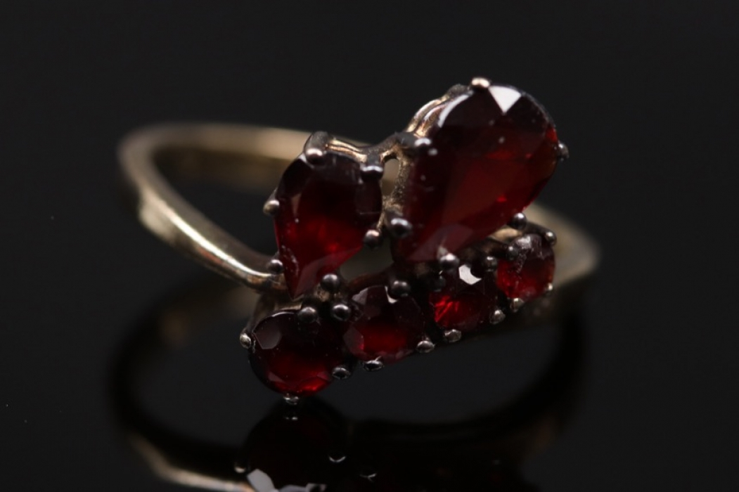 Golden ring with different shaped red garnets