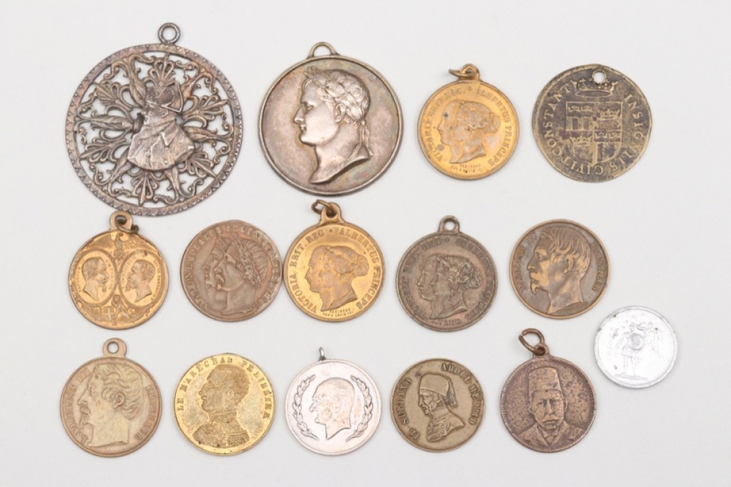 15 + international medals and badges