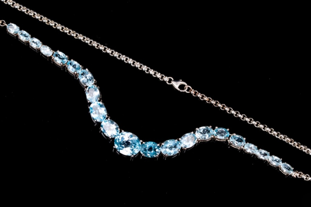 Silver necklace with light blue topazes