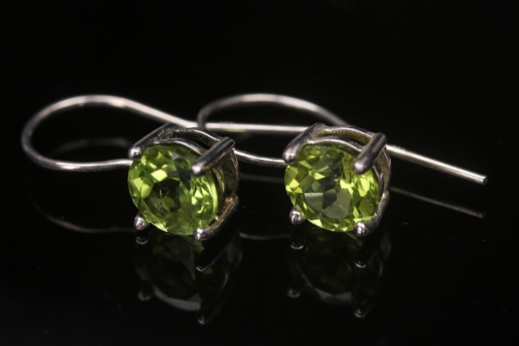 Silver earrings with green cubic zirconias