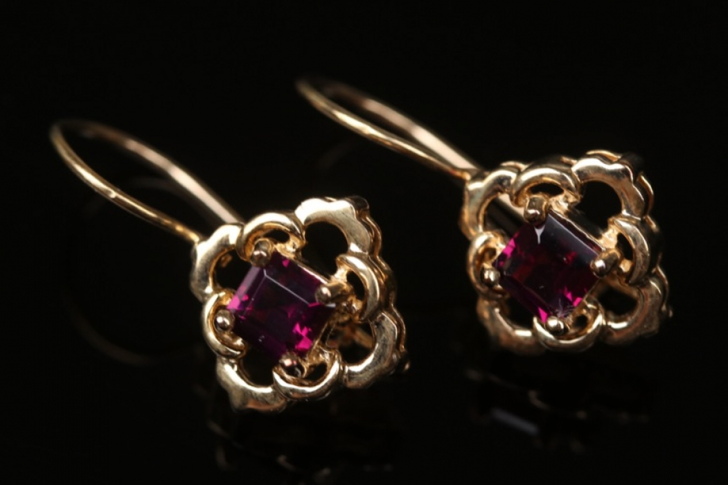 Gold plated silver earrings with magenta-colored garnets