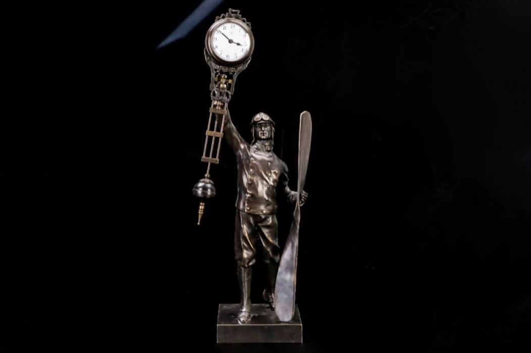 Junghans - Bronze figure of a pilot & pendulum shaped clock 20s/30s