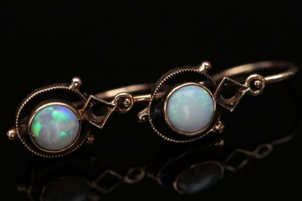 Pair of delicate opal earrings