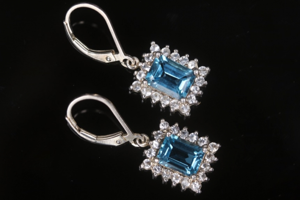Silver earrings with blue topazes