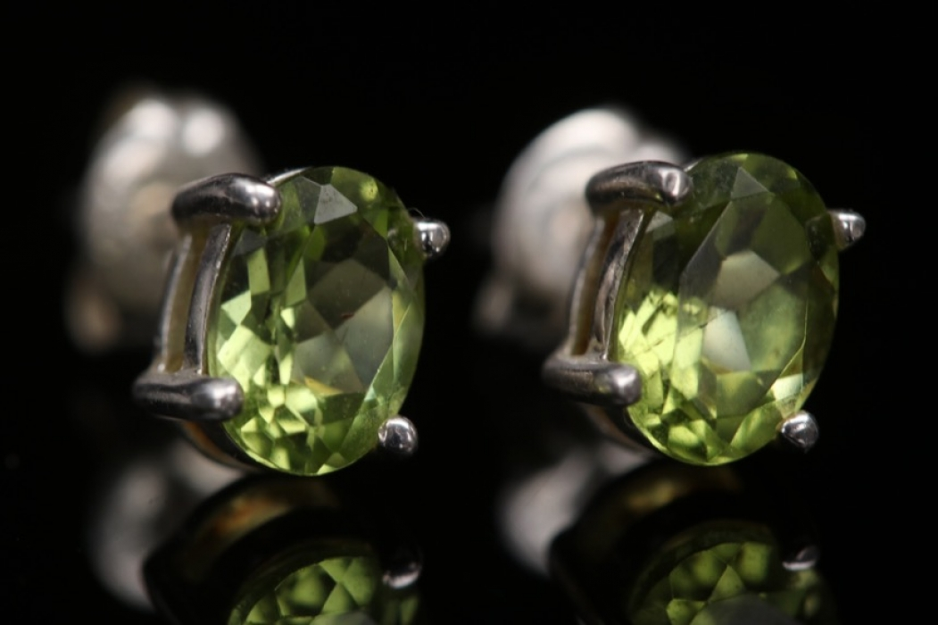 Small silver ear studs with peridot