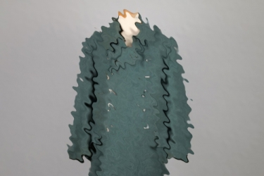 Police winter coat with removed SS eagle